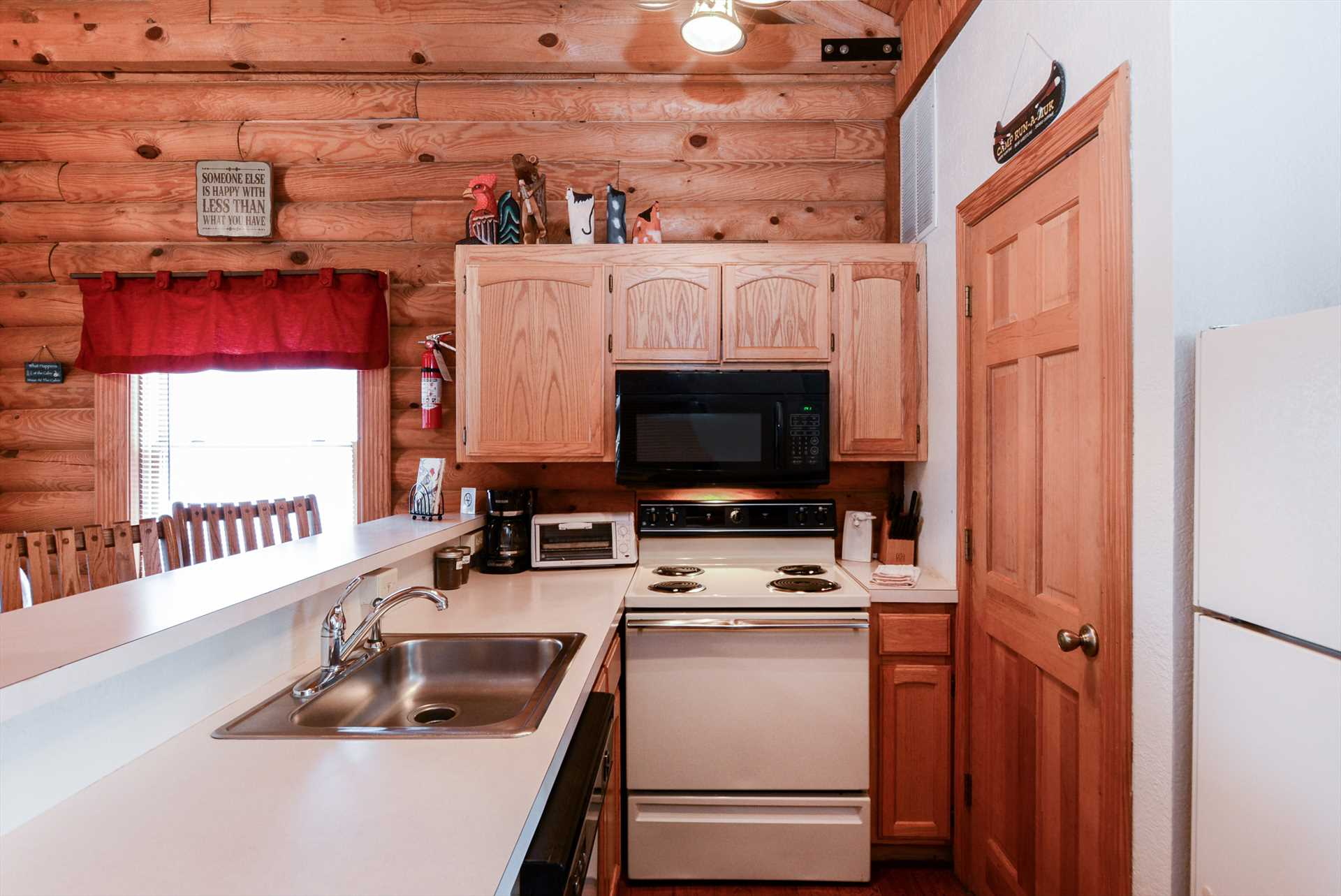 The fully-equipped kitchen is open to the living area.