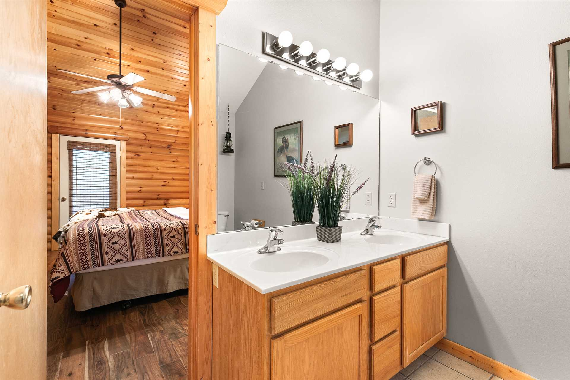 This bathroom has a double vanity and a jetted tub.