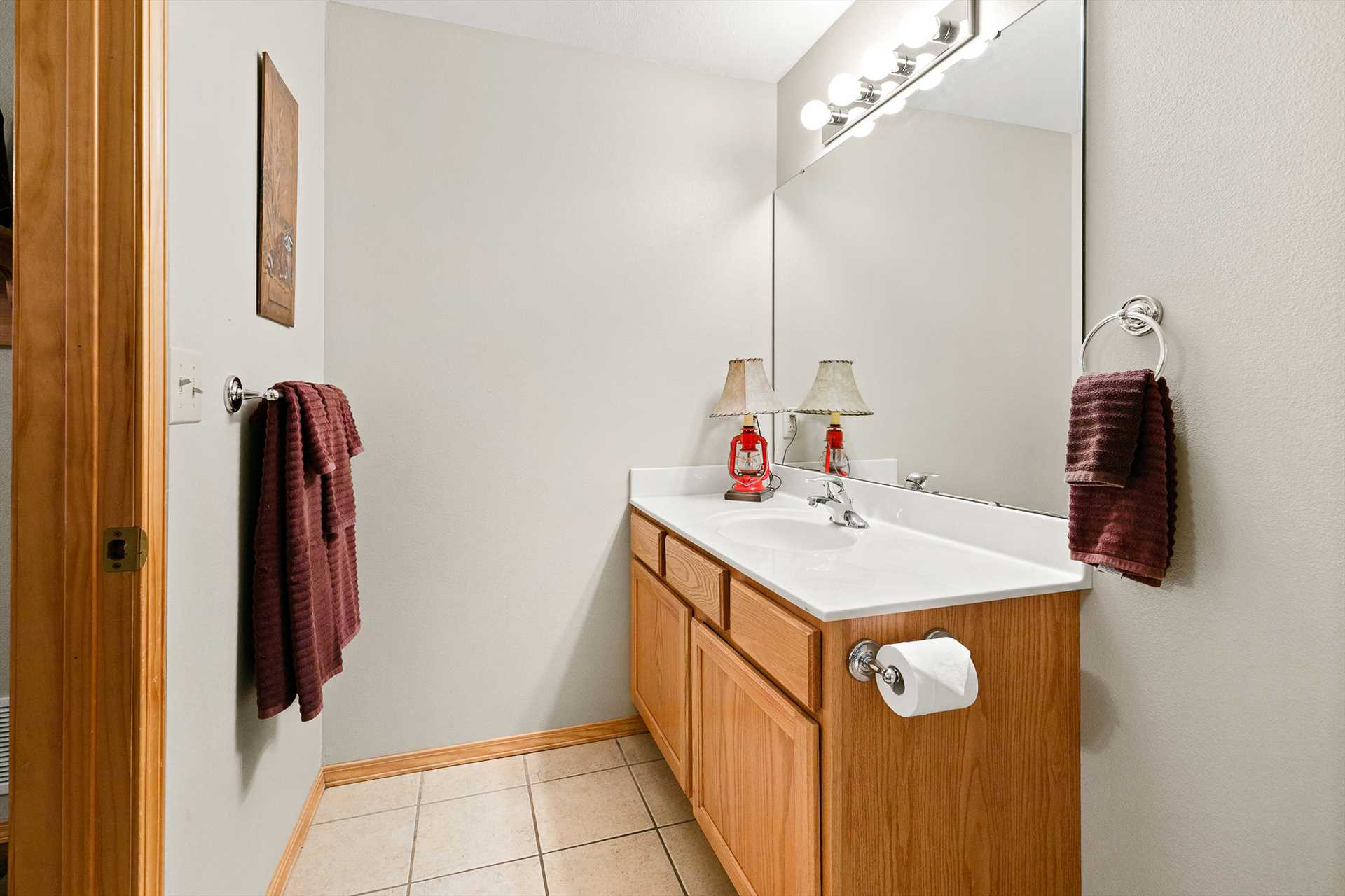 The attached bathroom has a large tub and shower combo.