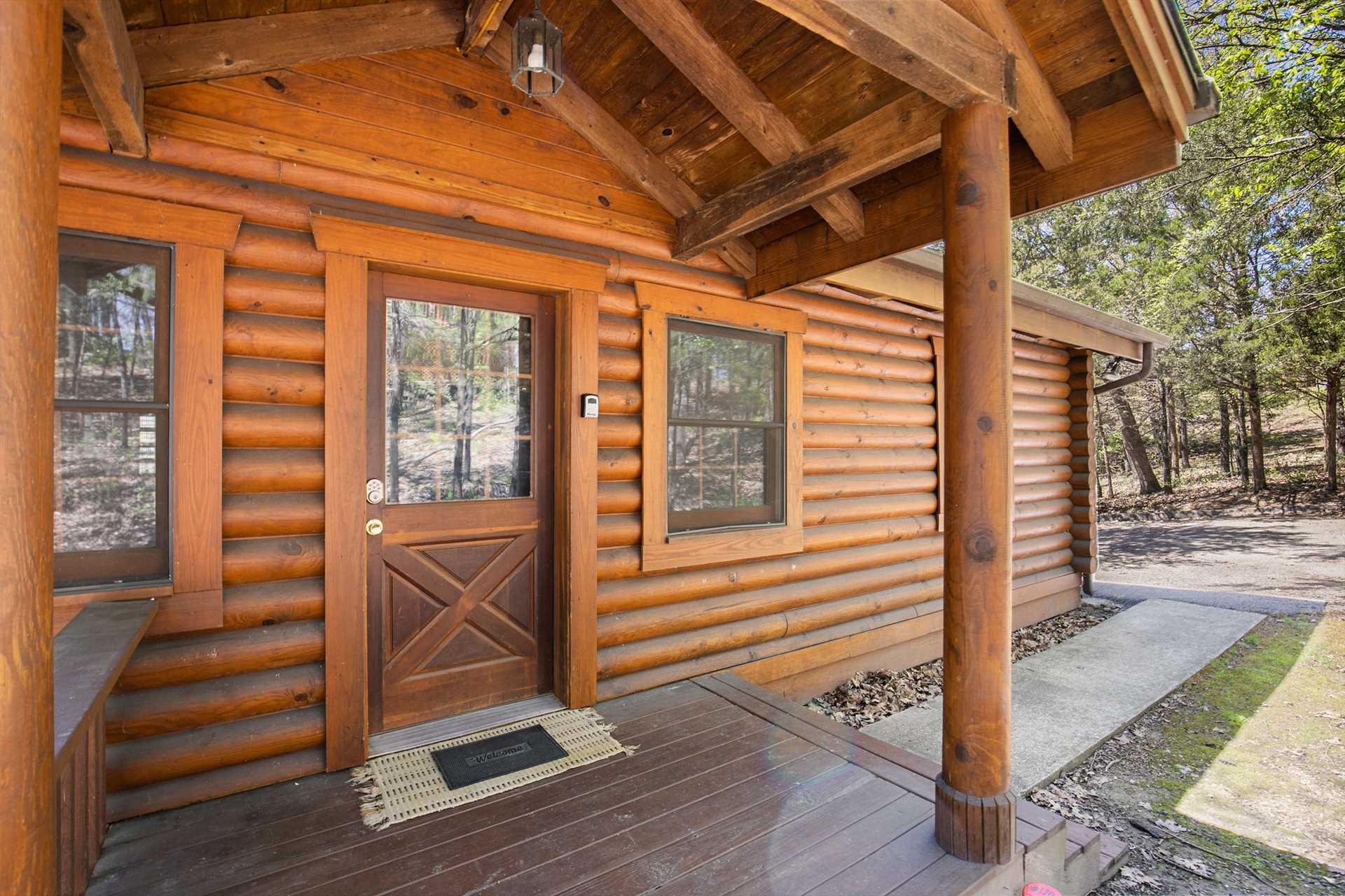 This Branson Woods cabin features authentic log construction