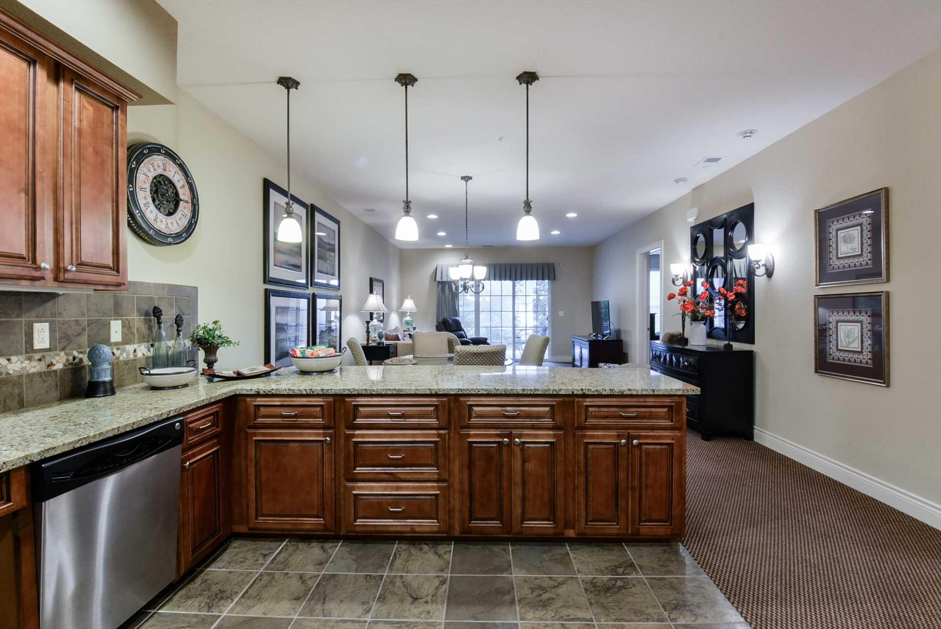 The kitchen overlooks the living area.