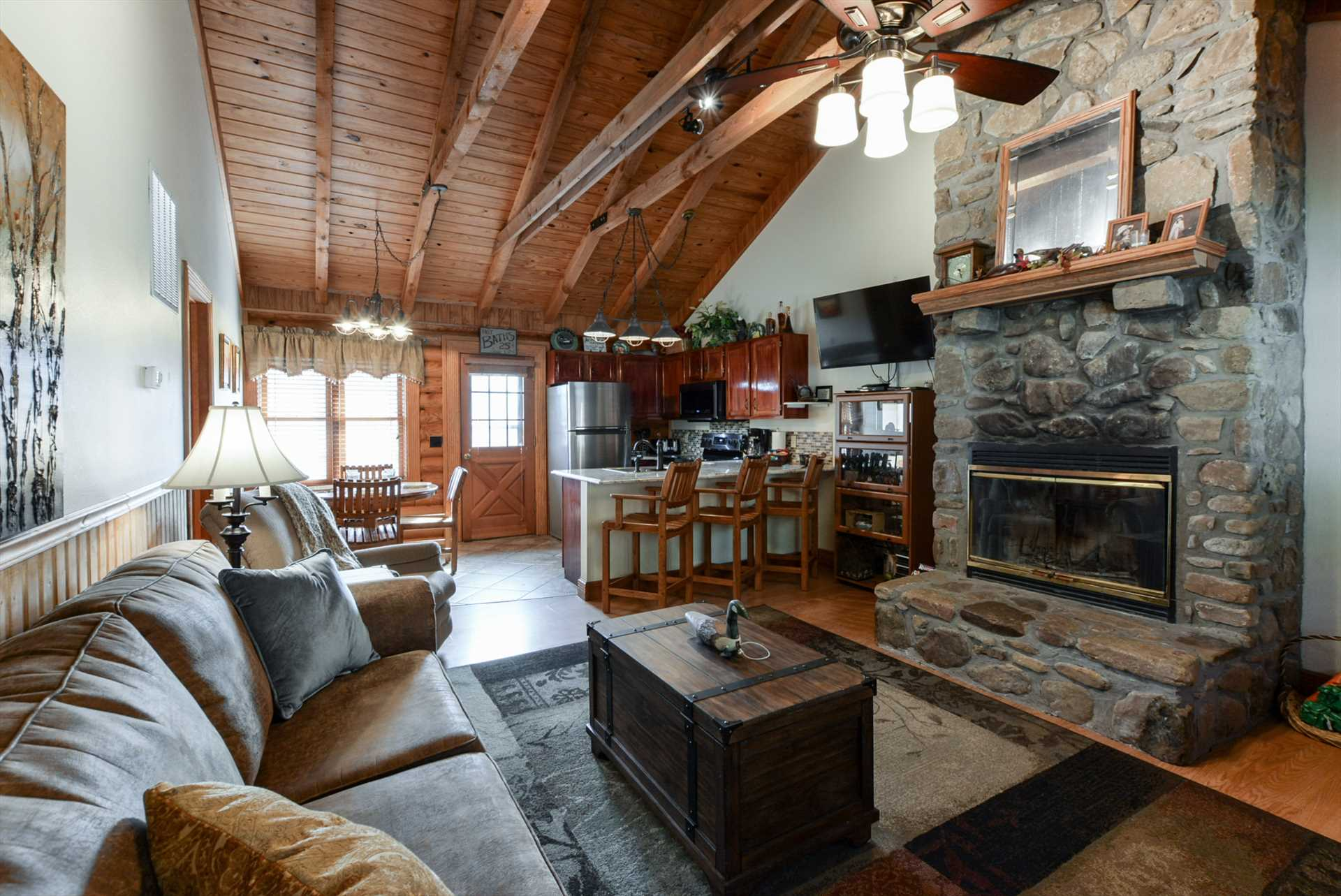 High ceilings and exposed wooden beams give this property it