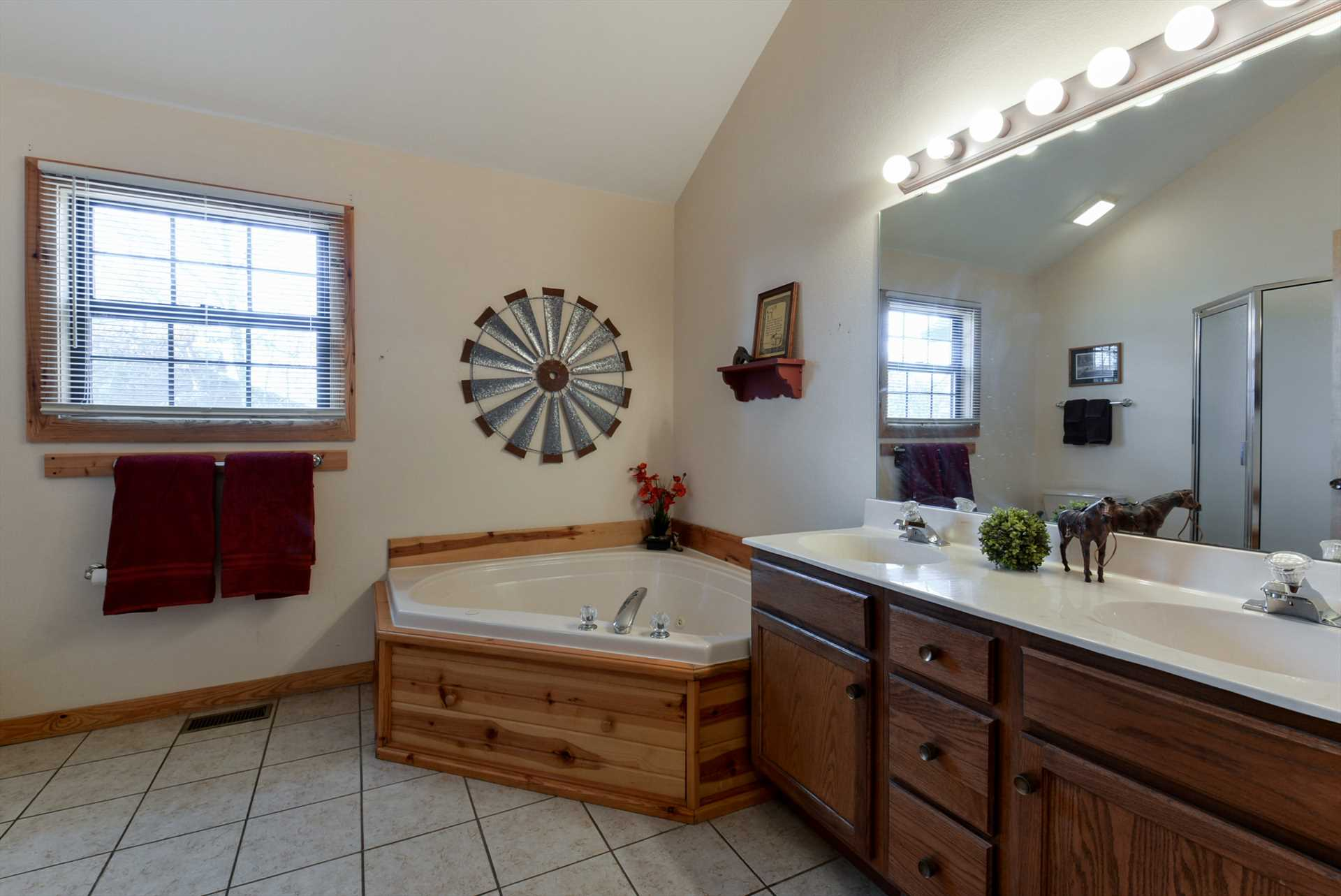 Both bathrooms include walk-in showers and whirlpool tubs.