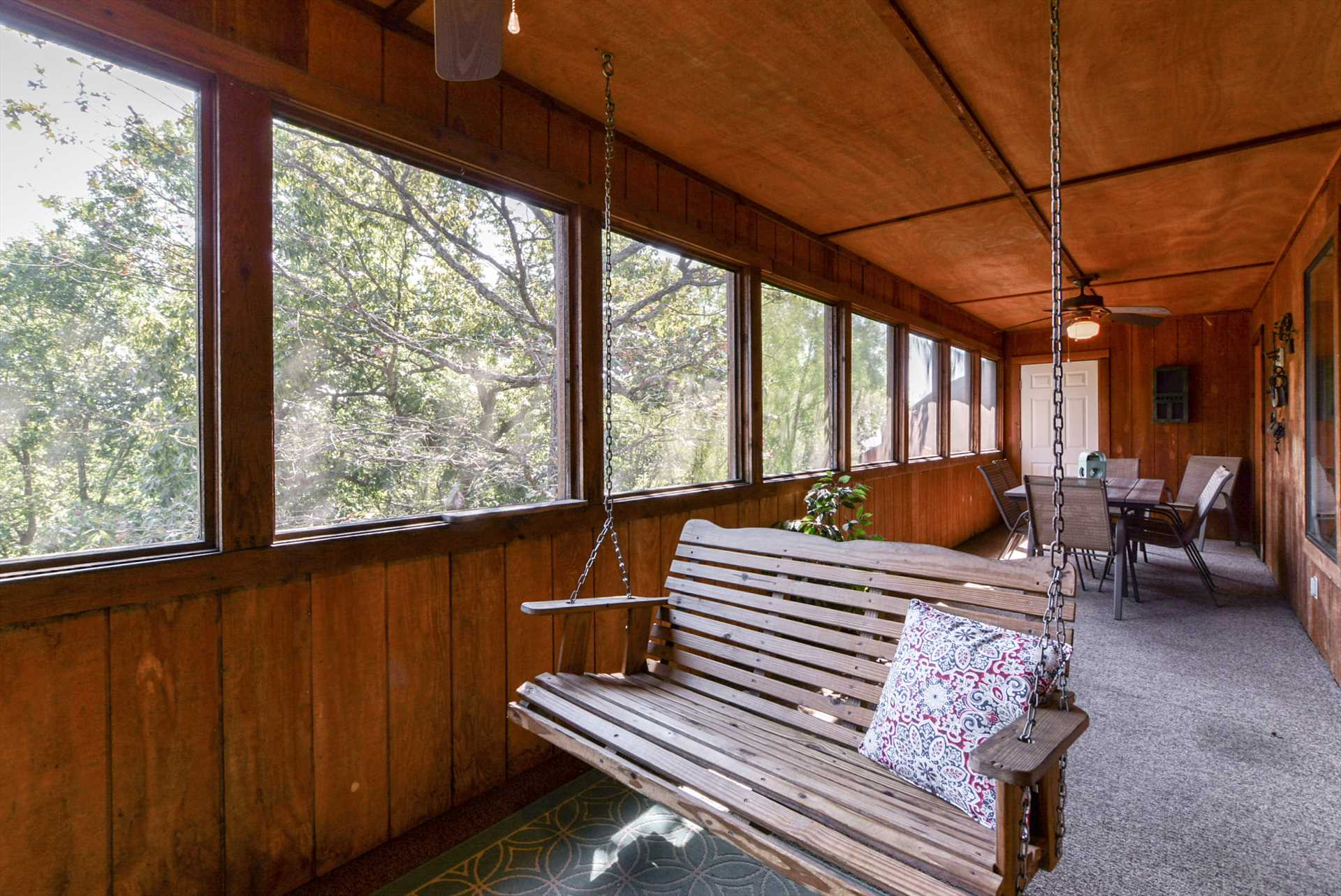There's plenty of space on the screened-in porch for th