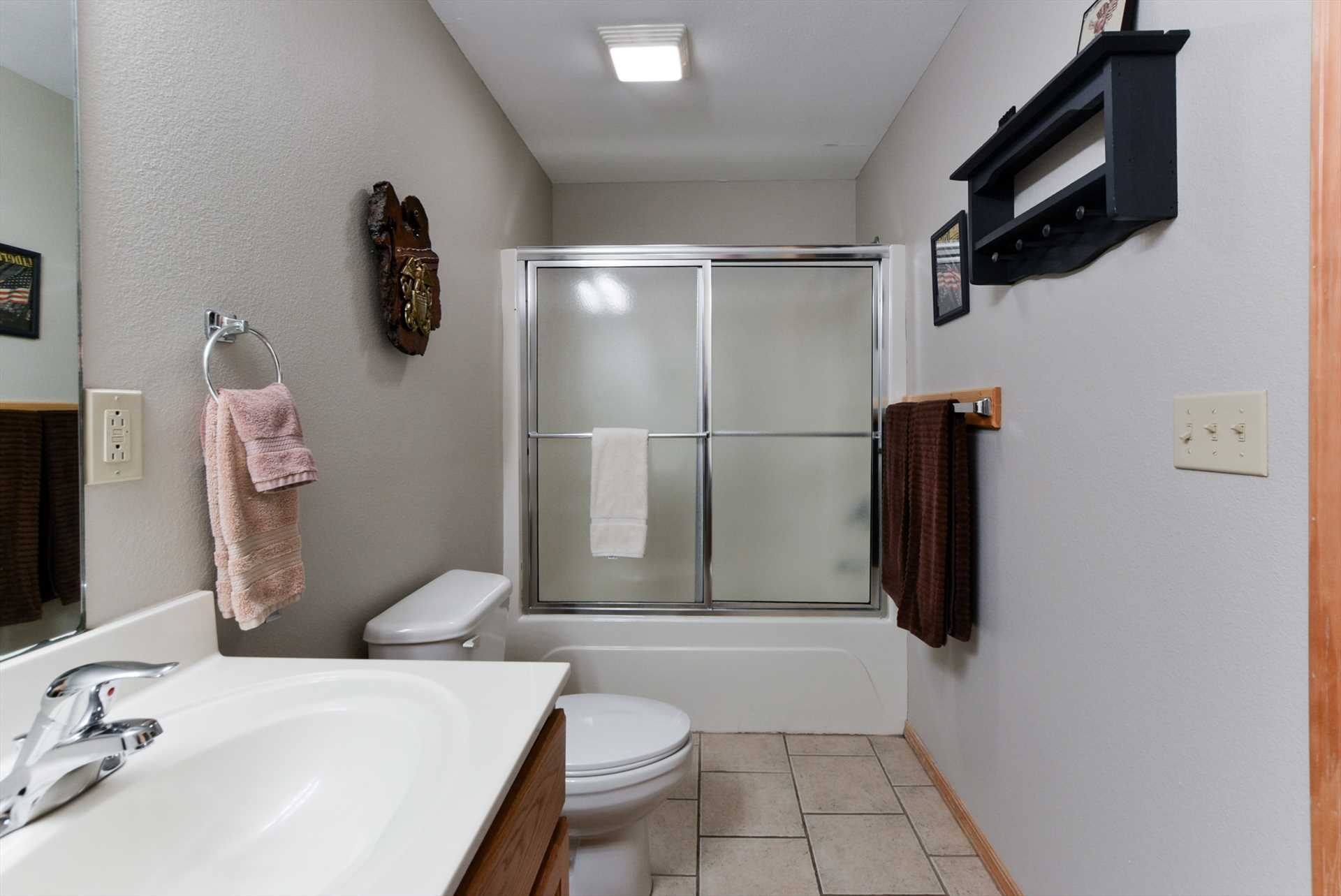 This bathroom includes a combination shower/tub.