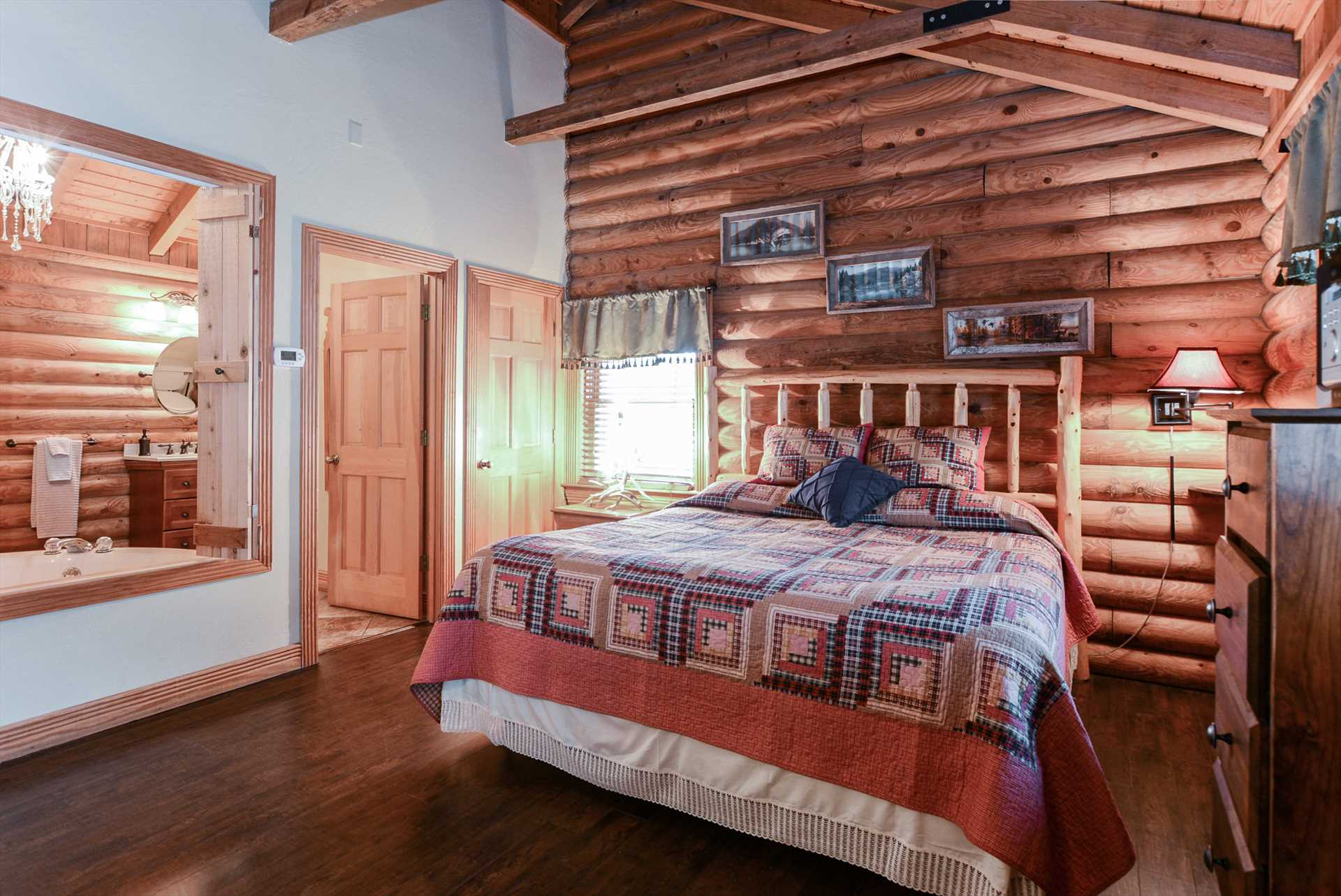 The rustic charm of the cabin continues into the bedroom are