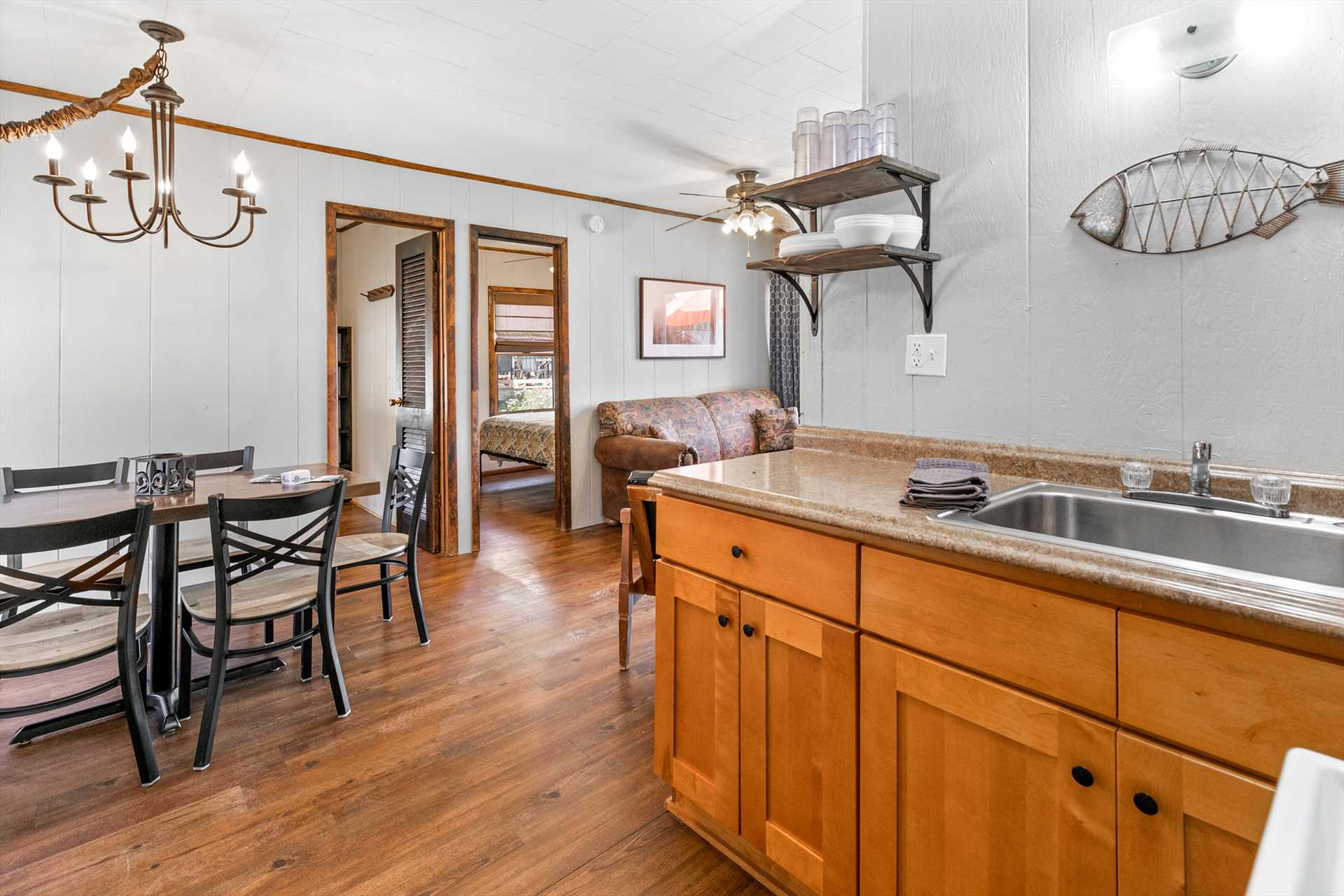 The kitchen is open to the living an dining areas.