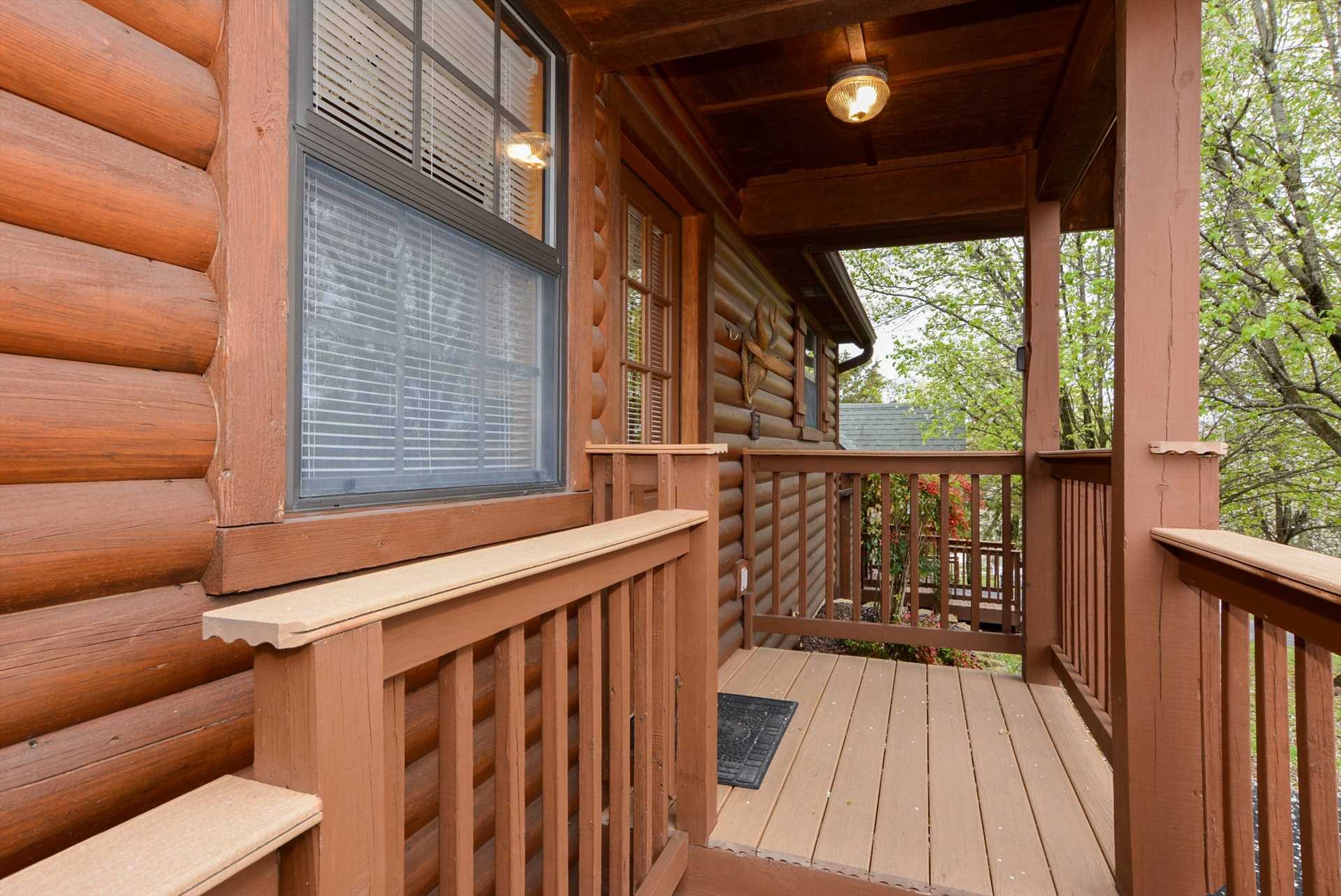 The covered front porch welcomes you to this perfect ozarks