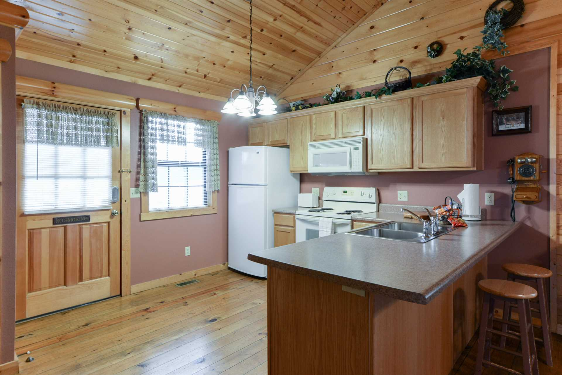 The kitchen includes full-size appliances and plenty of coun