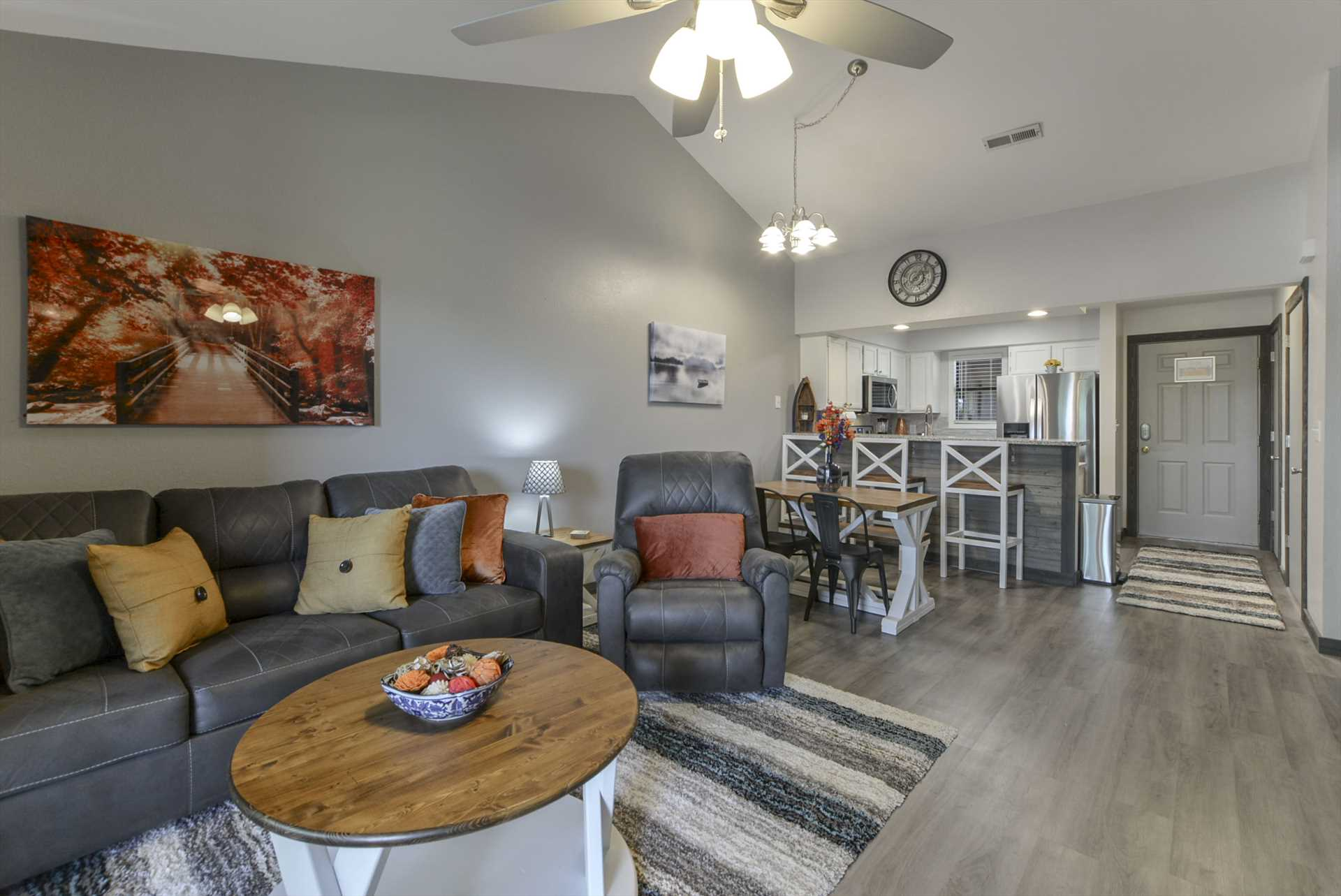 The spacious living area is open to the kitchen, and include