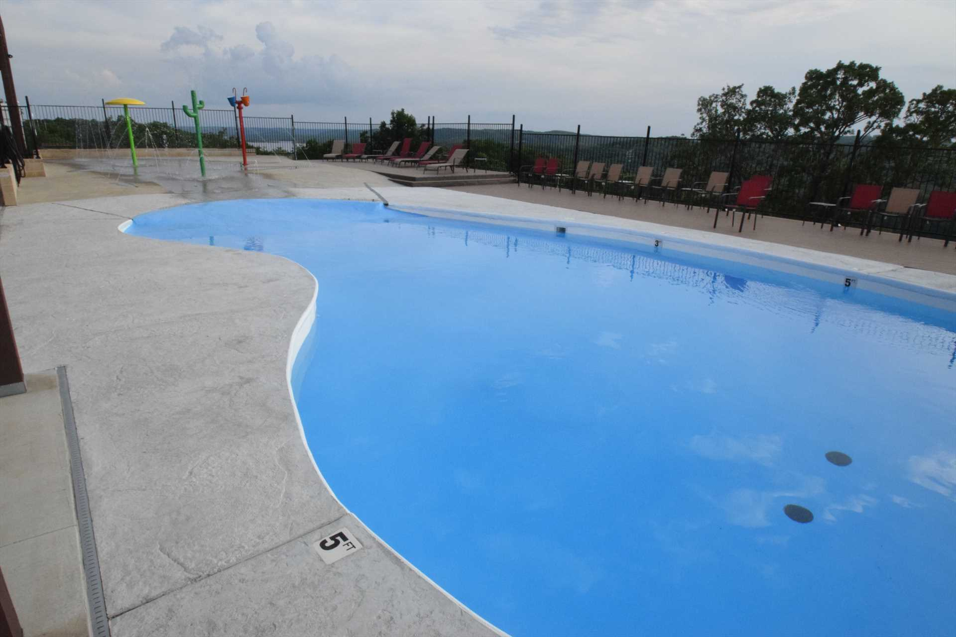 The outdoor pool has beautiful views of the lake.