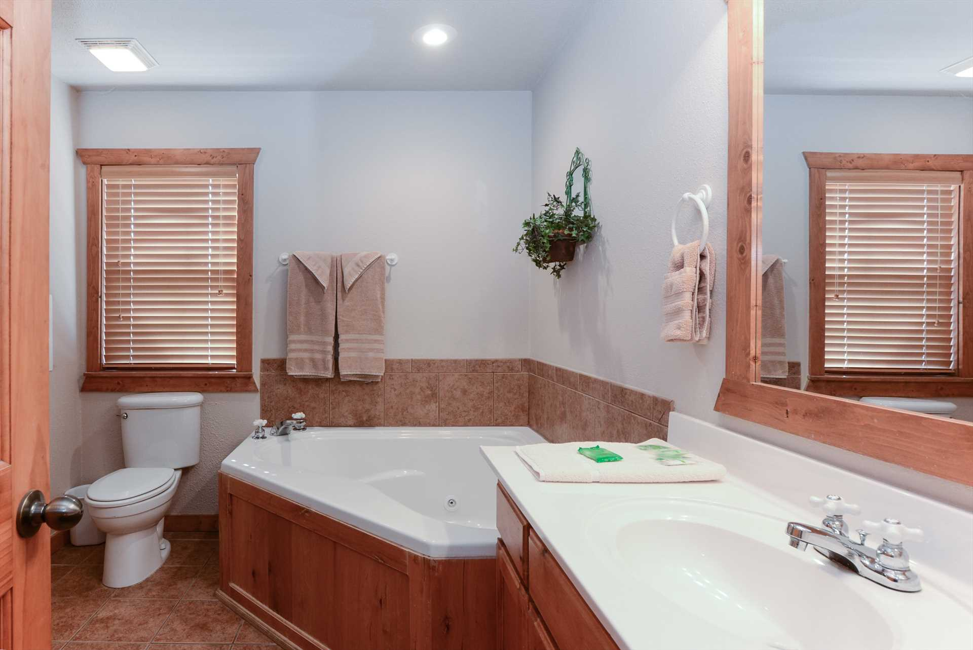 One of the master baths with whirlpool tub and seperate show