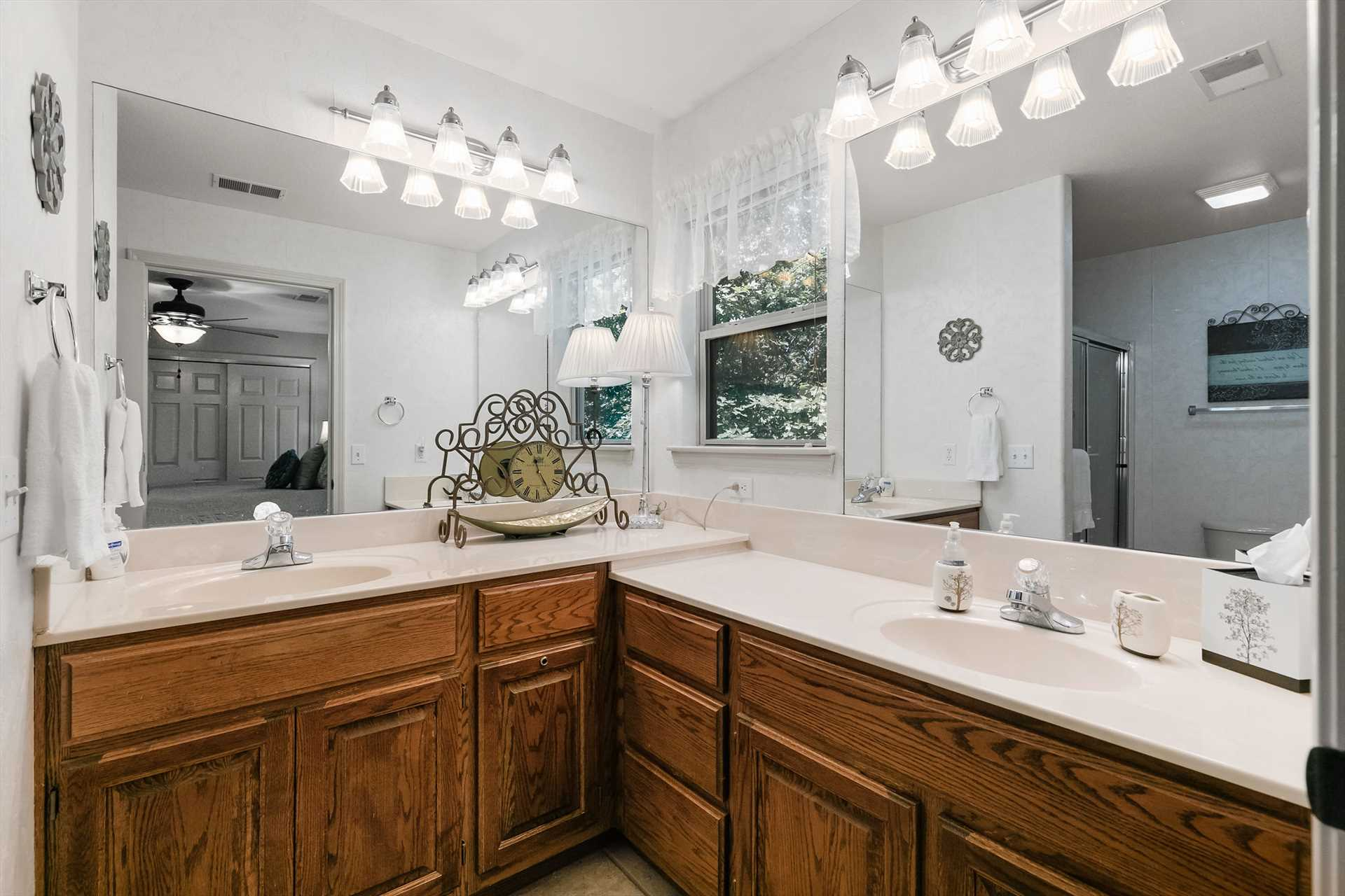 The large bathroom boasts two sinks.