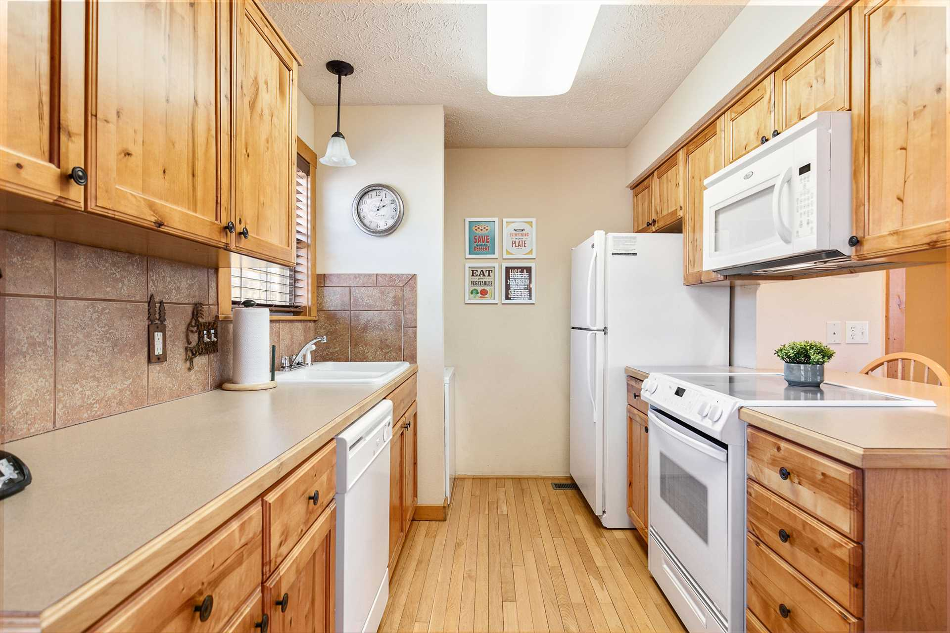 The kitchen includes full-sized appliances.