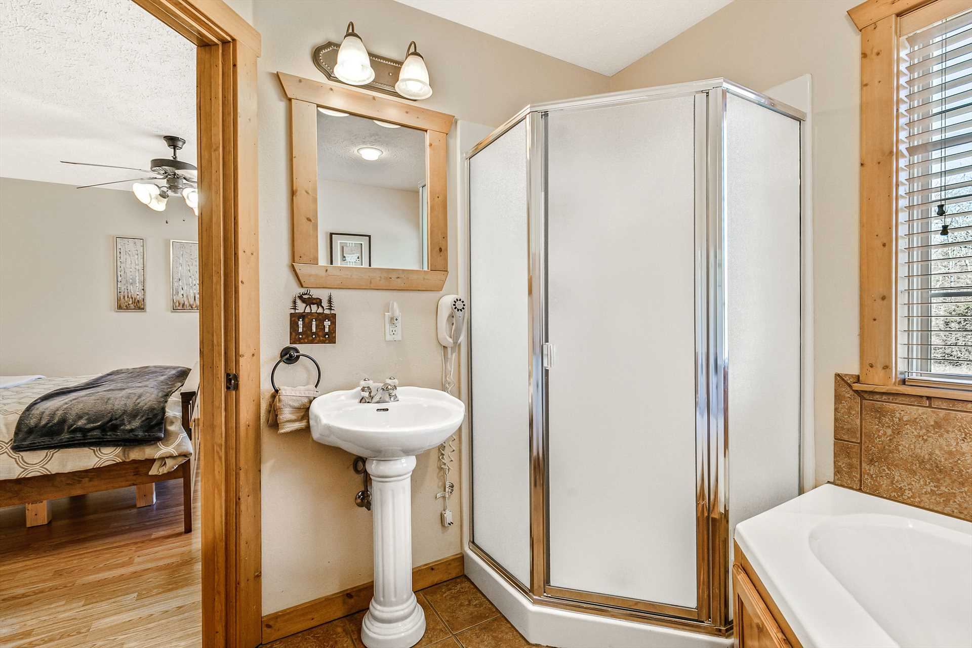 This bedroom is adjacent to the bedroom suite and includes a