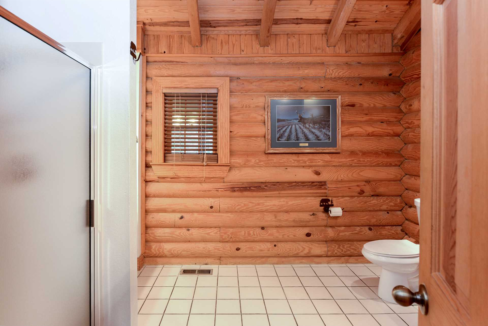 The spacious bathrooms keep the rustic decor of the cabin.