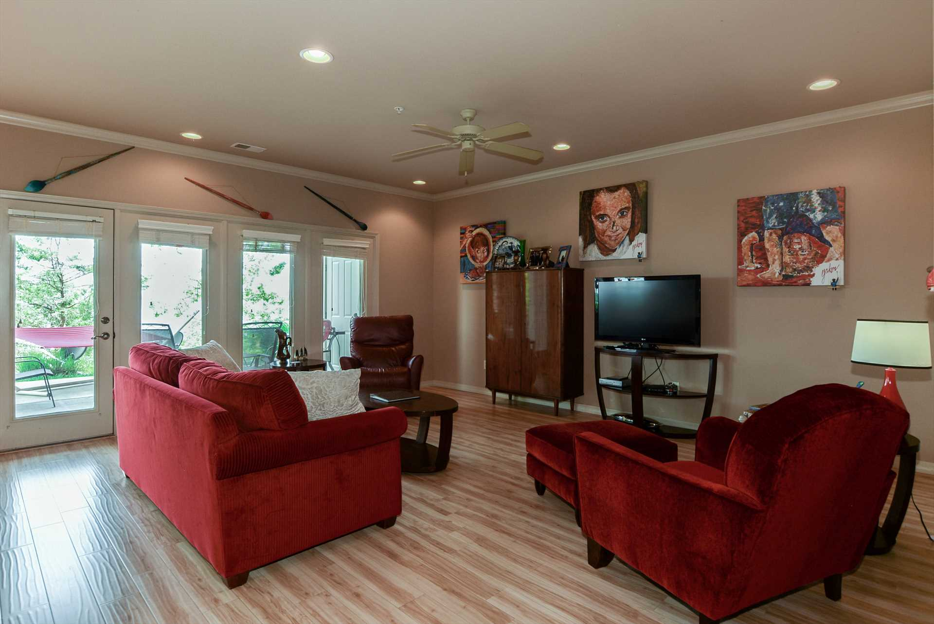 Living room includes large flat screen television and plenty
