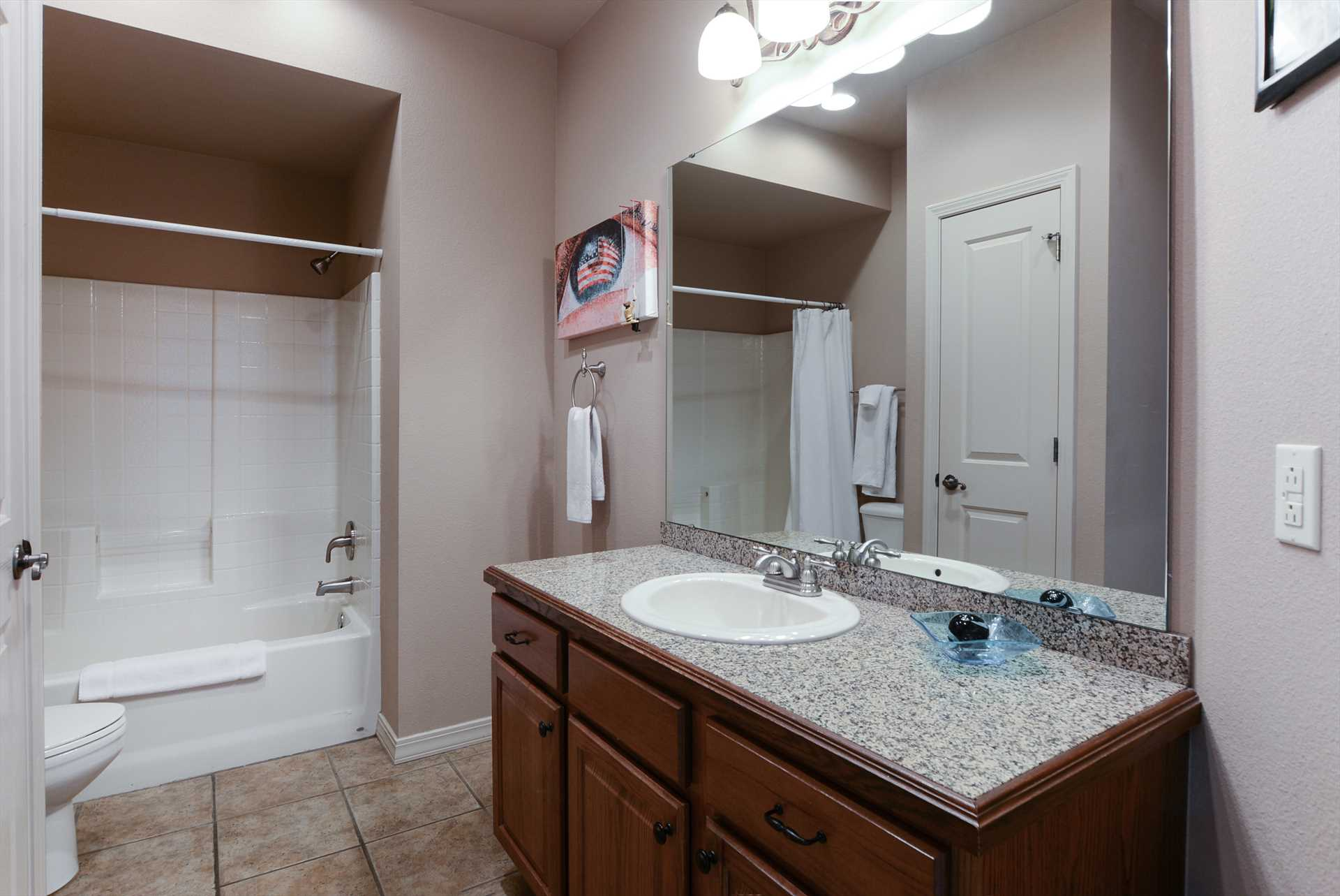 This spacious bathroom includes a full tub.