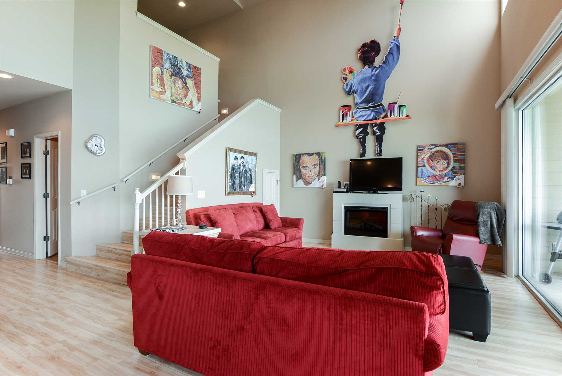 Unique art makes this living area a fun place to entertain f