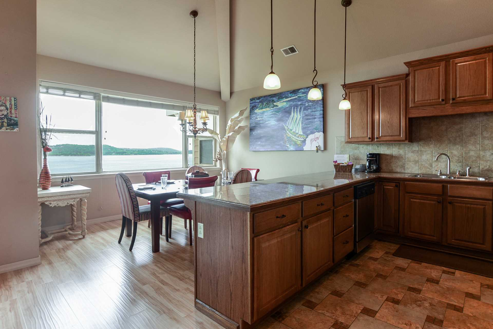 The fully-equipped kitchen is adjacent to the living area.