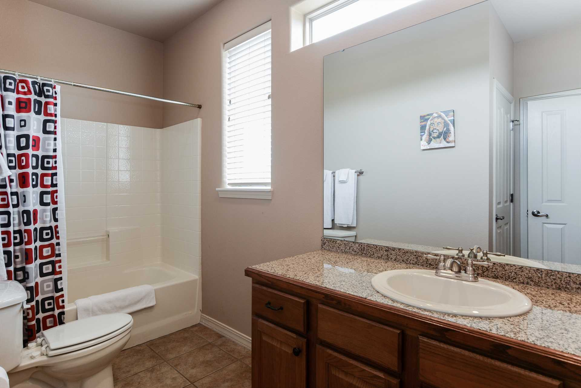 This bathroom includes a large tub.