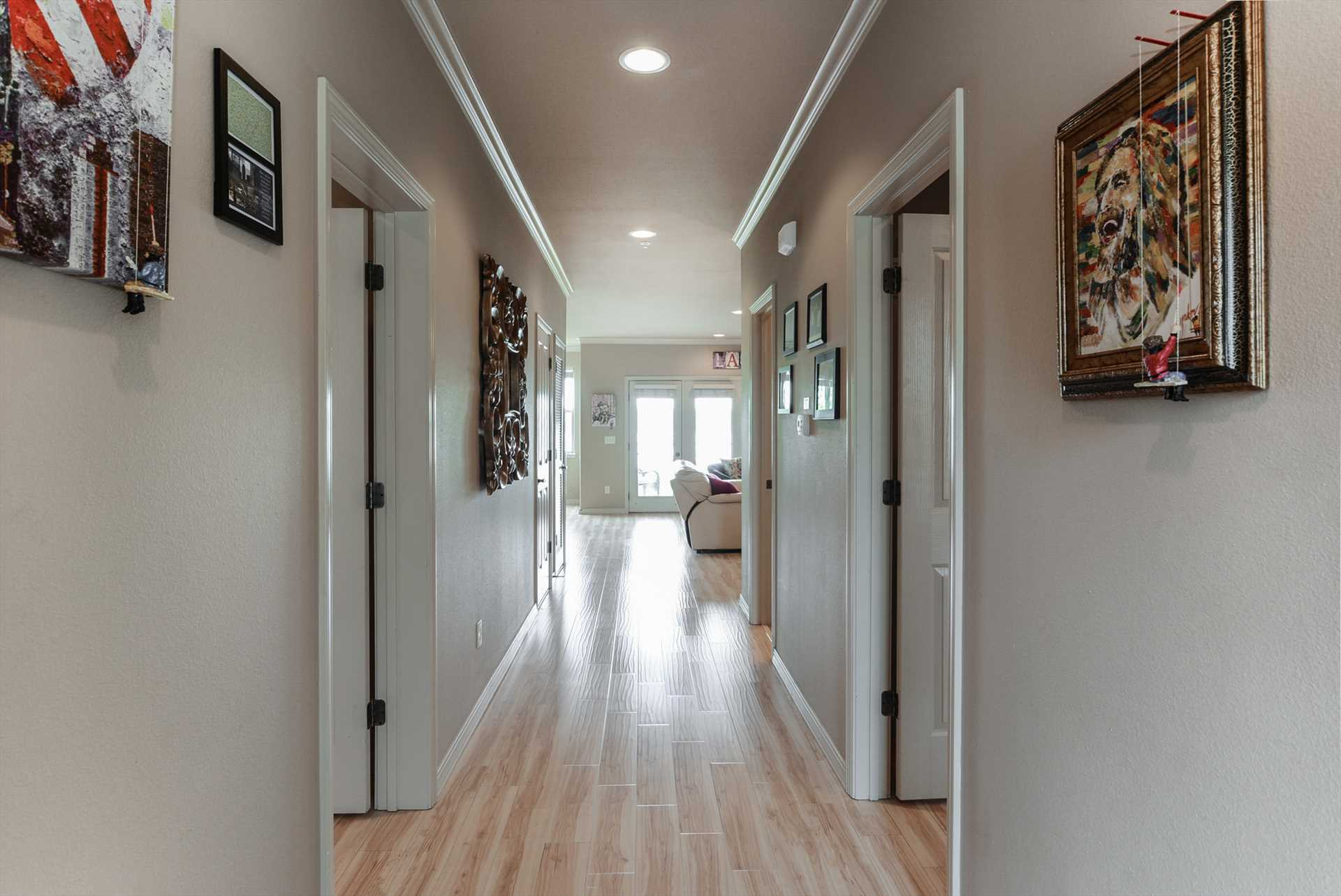 Hallway leads to large living area with adjacent fully-equip