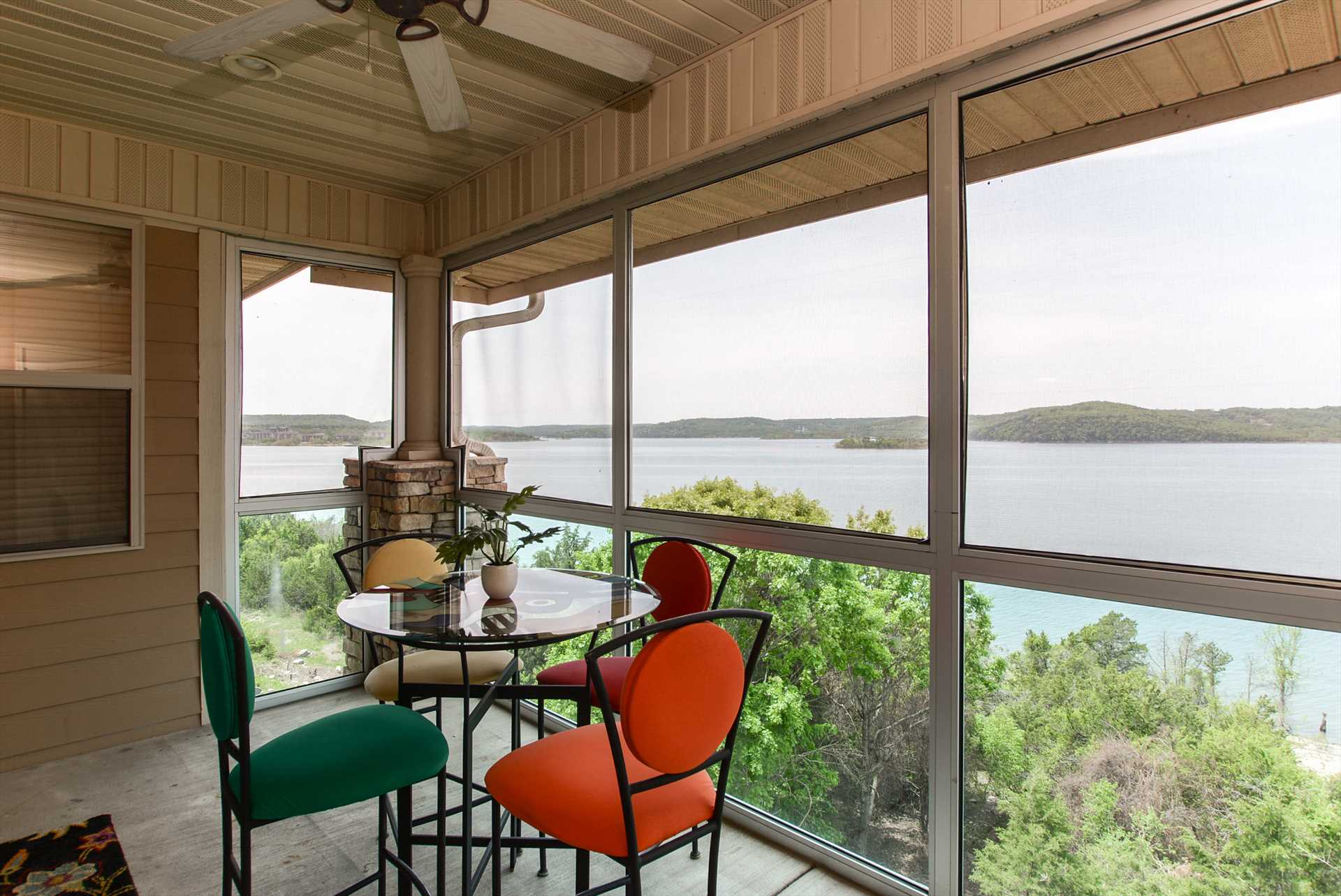 The screened in porch provides gorgeous views of the lake al